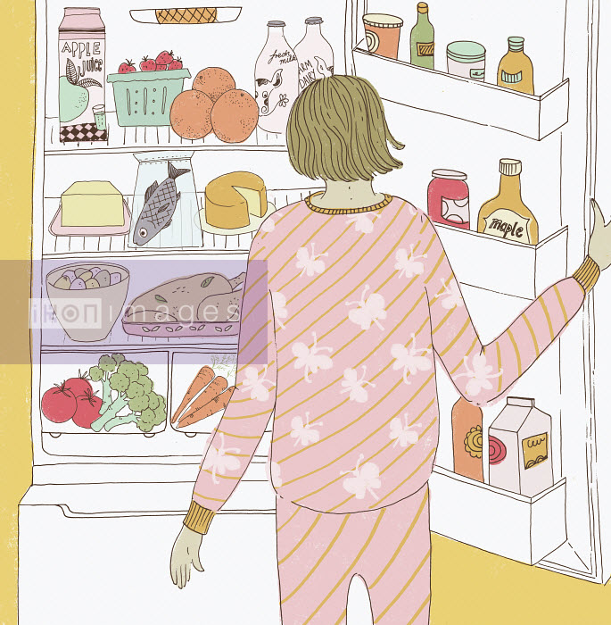 Woman wearing pajamas and looking in the fridge - Woman wearing pajamas and looking in the fridge - Trina Dalziel