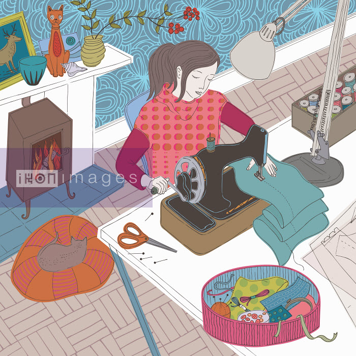 Young woman using sewing machine in cozy living room - Trina Dalziel