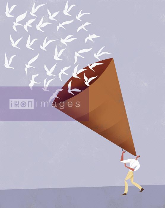 Man talking through large megaphone with flock of doves flying away - Man talking through large megaphone with flock of doves flying away - Gregory Baldwin