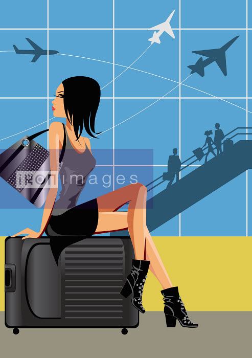 Beautiful woman sitting on baggage at airport - Beautiful woman sitting on baggage at airport - Nicole Onslow