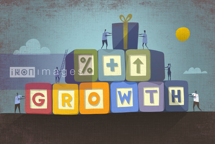 Businesspeople working together building single word 'growth' in building blocks - Businesspeople working together building single word 'growth' in building blocks - Rocco Baviera