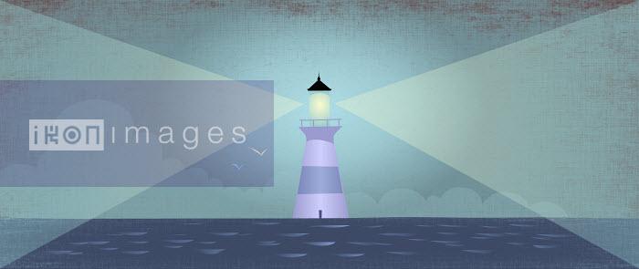 Beam of light shining from lighthouse at sea - Beam of light shining from lighthouse at sea - Rocco Baviera