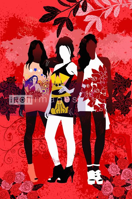 Ade Akinrujomu - Fashionable teenage girls wearing t shirts posing in red countryside