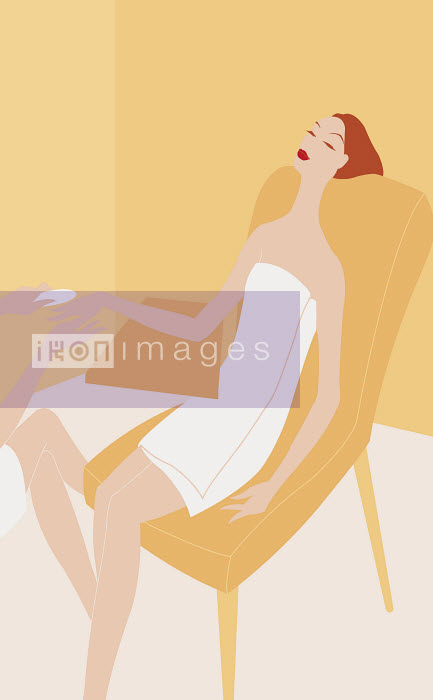 Beautiful woman wrapped in a towel receiving manicure in spa - Beautiful woman wrapped in a towel receiving manicure in spa - Wai