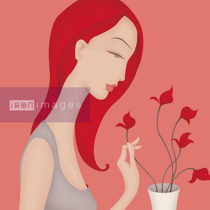 Beautiful woman arranging flowers in vase - Beautiful woman arranging flowers in vase - Wai