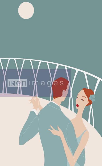 Romantic couple dancing on balcony at night - Romantic couple dancing on balcony at night - Wai