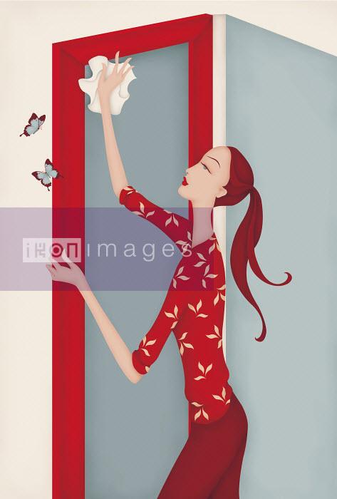 Beautiful woman dusting door frame - Beautiful woman dusting door frame - Wai