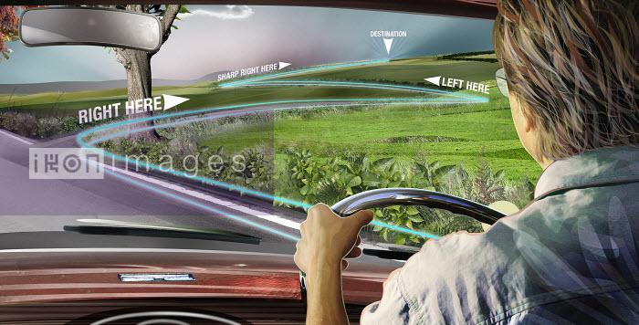 Man driving car using global positioning system - Man driving car using global positioning system - Derek Bacon