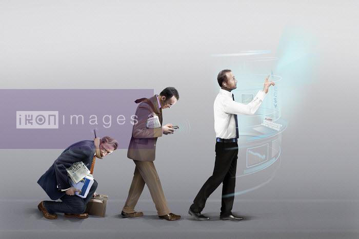 Three businessmen in stages of evolution of mobile communication technology - Three businessmen in stages of evolution of mobile communication technology - Derek Bacon