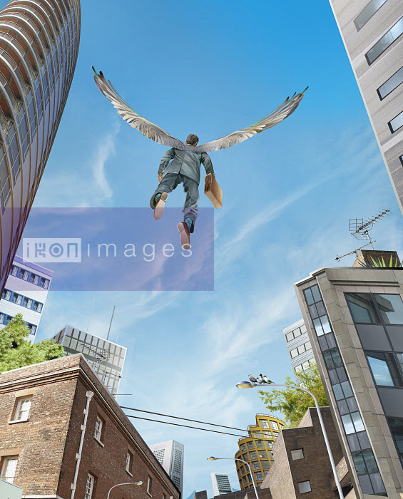Successful businessman with wings flying over city - Successful businessman with wings flying over city - Derek Bacon