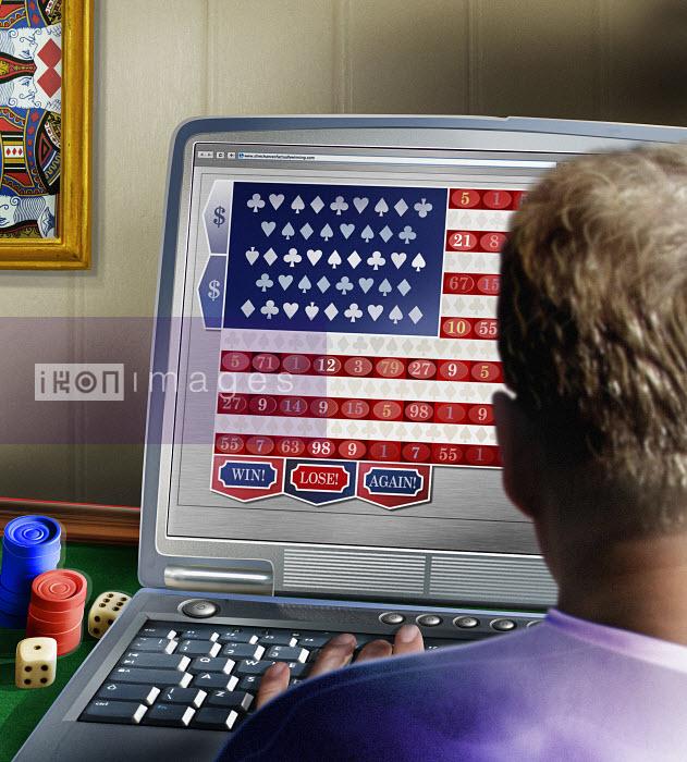 Man using laptop for online gambling - Man using laptop for online gambling - Derek Bacon