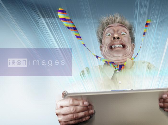 Businessman struggling to hold fast powerful laptop - Businessman struggling to hold fast powerful laptop - Derek Bacon