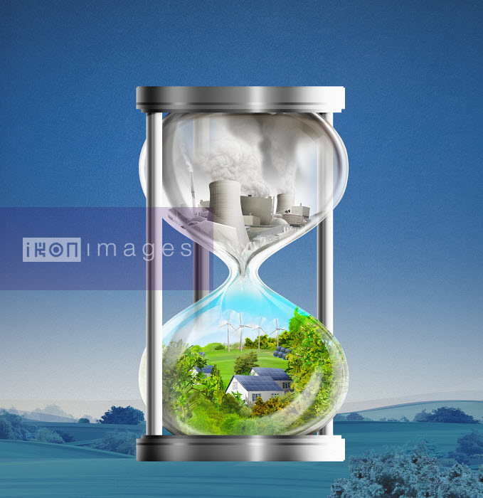 Hourglass with idyllic green energy contrasting with fossil fuel power station - Hourglass with idyllic green energy contrasting with fossil fuel power station - Derek Bacon