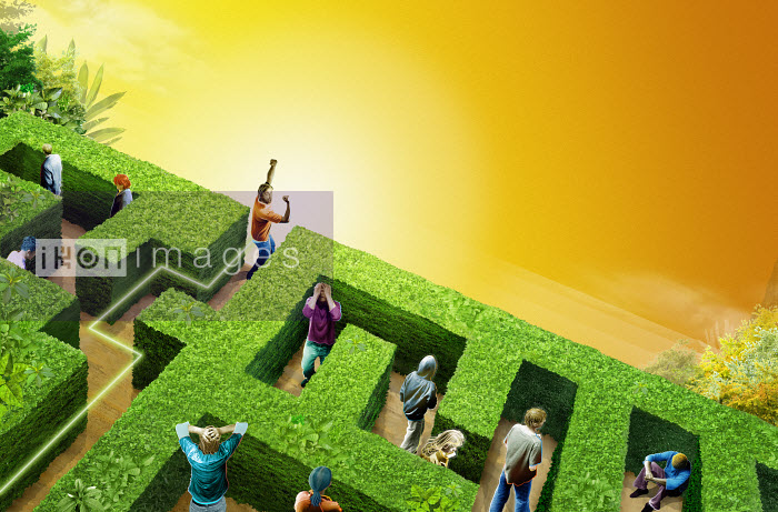 Man celebrating finding exit in hedge maze - Man celebrating finding exit in hedge maze - Derek Bacon