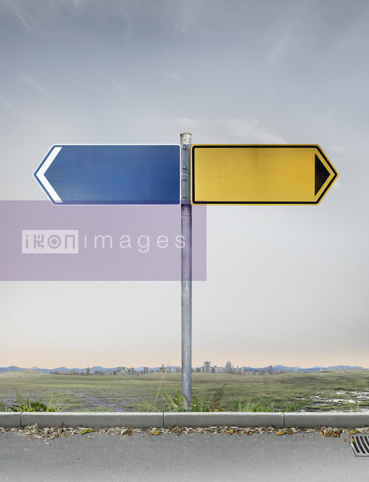 Blank yellow and blue road signs pointing in opposite directions - Blank yellow and blue road signs pointing in opposite directions - Derek Bacon