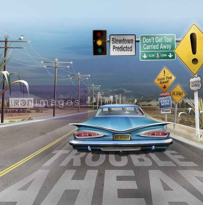 Road signs warning car of economic slowdown - Road signs warning car of economic slowdown - Derek Bacon
