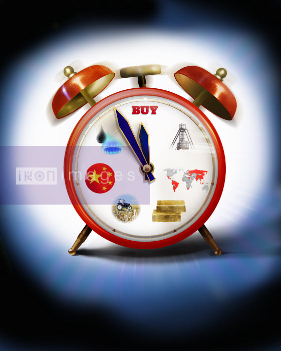 Alarm clock with commodities on clock face hands approaching midnight - Alarm clock with commodities on clock face hands approaching midnight - Derek Bacon