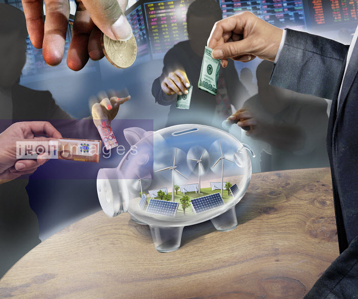 Business people investing money in transparent piggy bank containing renewable energy - Business people investing money in transparent piggy bank containing renewable energy - Derek Bacon