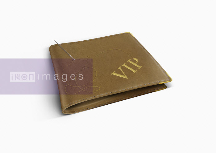 The letters VIP being embroidered on wallet - The letters VIP being embroidered on wallet - Derek Bacon
