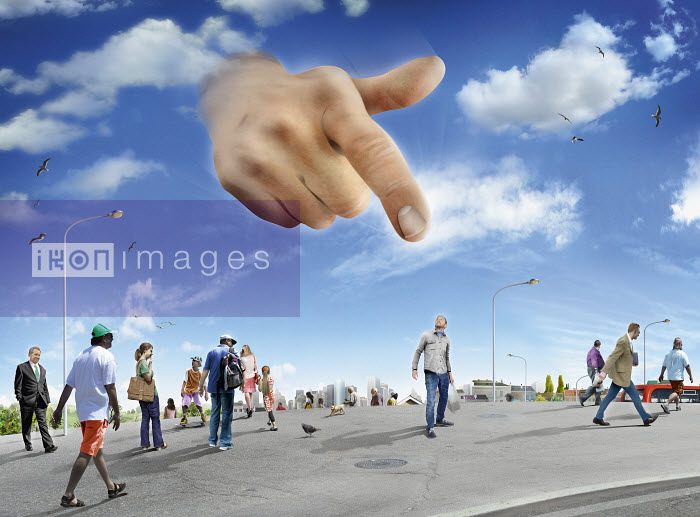 Large hand in sky pointing to man standing out from the crowd - Derek Bacon
