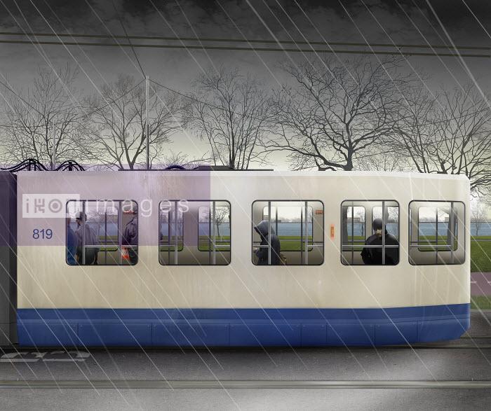 Passengers travelling in tram on rainy day - Derek Bacon