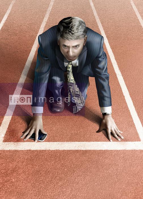 Businessman with money tie on starting line of athletics track - Derek Bacon
