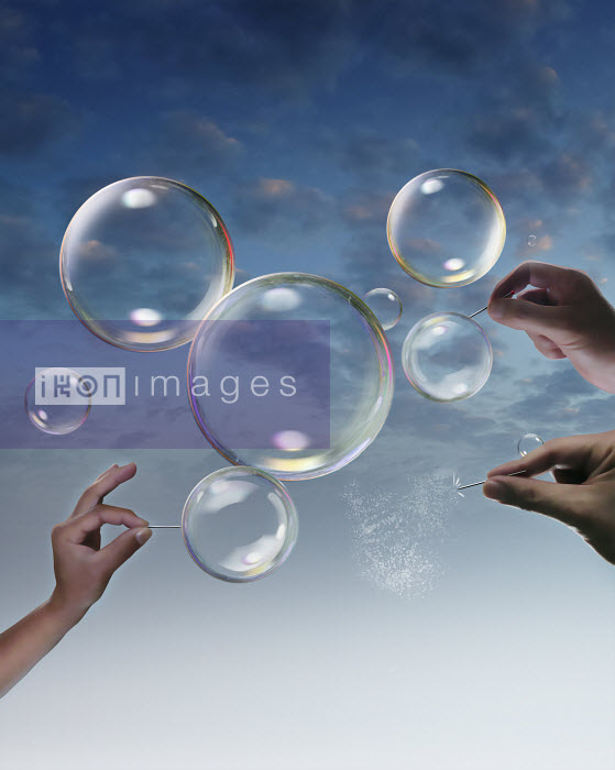 Hands bursting bubbles - Derek Bacon