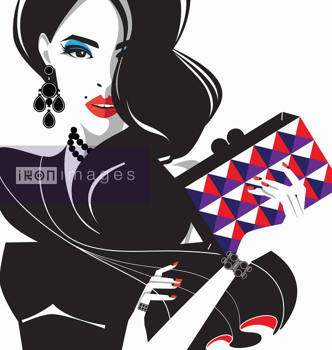 Glamorous fashion model with patterned clutch bag - Glamorous fashion model with patterned clutch bag - Yordanka Poleganova