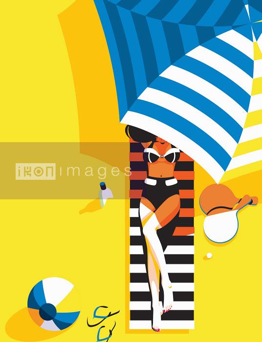 Woman relaxing on beach towel under parasol - Woman relaxing on beach towel under parasol - Yordanka Poleganova