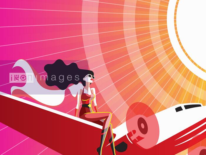 Female superhero sitting on flying aeroplane wing - Female superhero sitting on flying aeroplane wing - Yordanka Poleganova