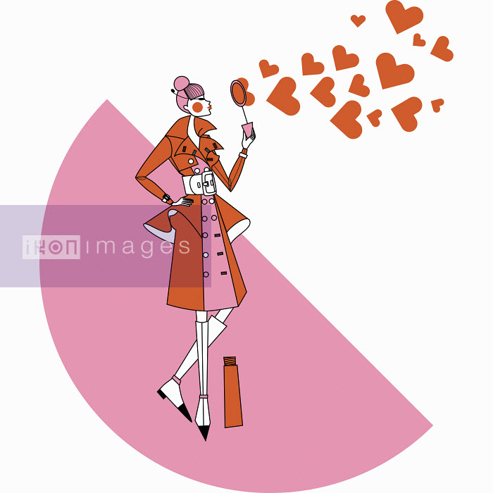 Fashionable woman blowing heart shape bubbles with bubble wand - Fashionable woman blowing heart shape bubbles with bubble wand - Yordanka Poleganova
