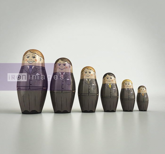 Businessmen nesting dolls in order of size and happiness - Businessmen nesting dolls in order of size and happiness - Cube