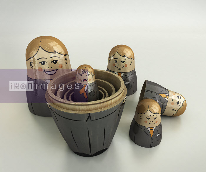 Small crying businessman revealed inside of open nesting dolls in order of size and happiness - Small crying businessman revealed inside of open nesting dolls in order of size and happiness - Cube