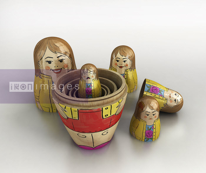 Small crying woman revealed inside of open nesting dolls in order of size and happiness - Small crying woman revealed inside of open nesting dolls in order of size and happiness - Cube