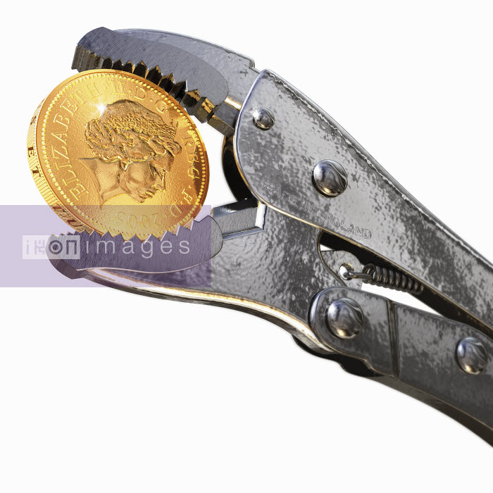 Pliers holding British one pound coin - Pliers holding British one pound coin - Ian Naylor