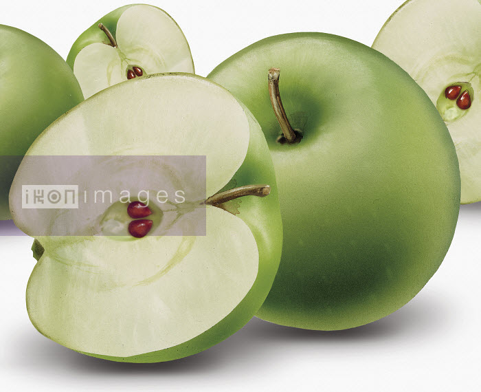 Close up of whole and halved green apples - Close up of whole and halved green apples - Syd Brak