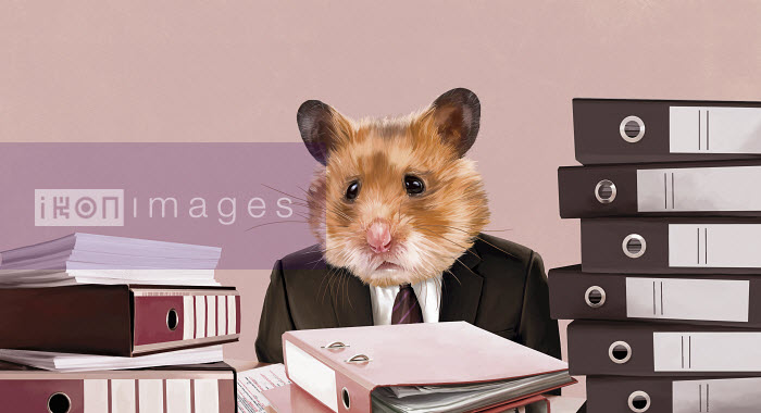 Hamster businessman sitting at desk with piles of work - Hamster businessman sitting at desk with piles of work - Mart Klein