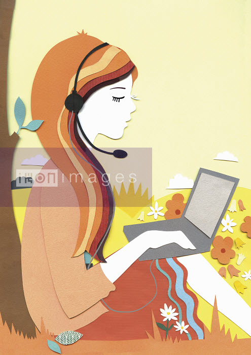 Woman working on laptop using hands-free device in countryside - Woman working on laptop using hands-free device in countryside - Vicky Scott