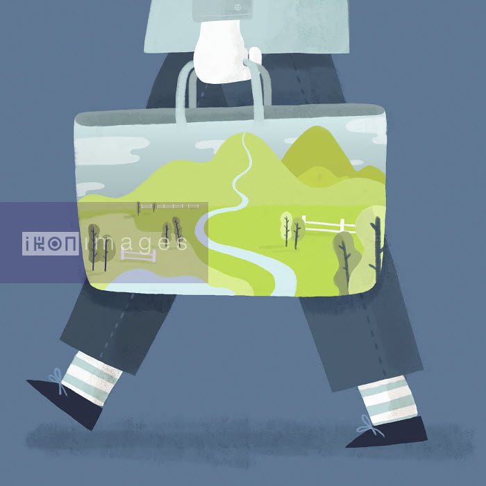 Man carrying image of scenic landscape on bag - Man carrying image of scenic landscape on bag - Mark Conlan