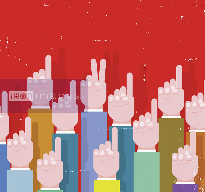 Businessman's hand making victory sign standing out from the crowd of raised hands - Businessman's hand making victory sign standing out from the crowd of raised hands - Nick Diggory