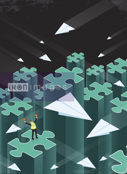 Air traffic controller directing paper airplanes between disconnected jigsaw puzzle piece columns - Air traffic controller directing paper airplanes between disconnected jigsaw puzzle piece columns - Nick Diggory