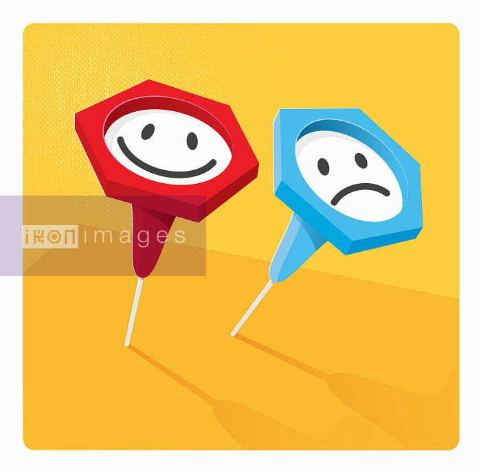 Contrasting indicator push pins with happy and sad smiley faces - Nick Diggory