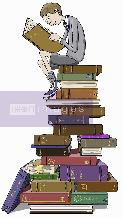 Schoolboy reading sitting on top of tall pile of books - Schoolboy reading sitting on top of tall pile of books - Andrew Pinder