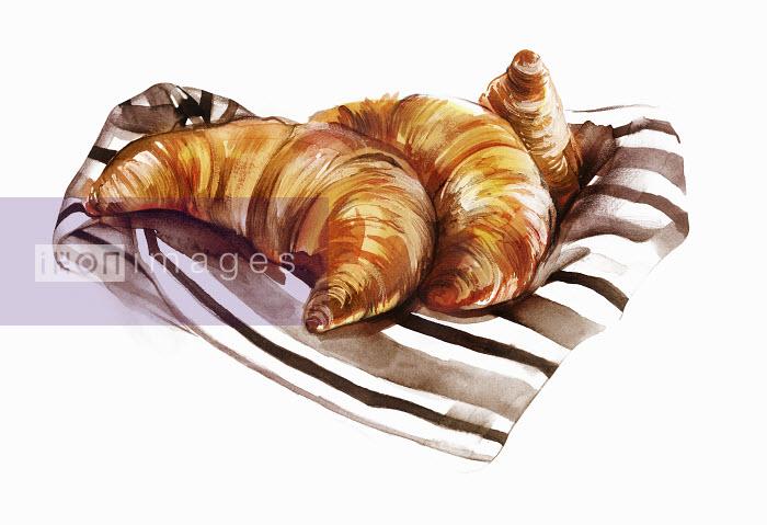 Croissants on striped napkin - Natalia Sanabria