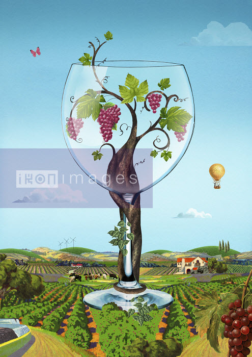 Valero Doval - Grape vine growing inside of large wine glass in idyllic rural landscape