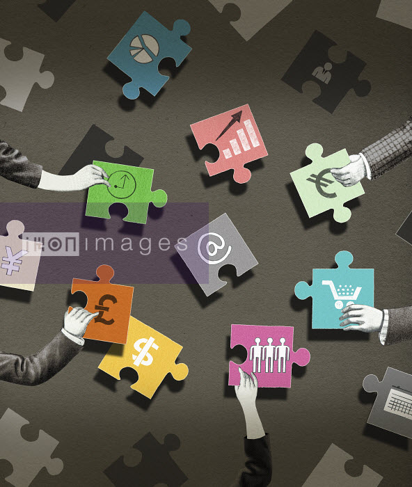Valero Doval - Business people arranging jigsaw puzzle pieces with economic symbols