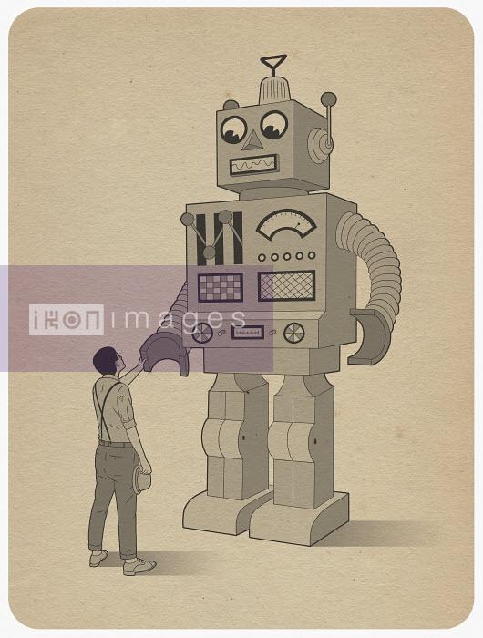 Man shaking hand of large robot - Man shaking hand of large robot - Robbie Porter