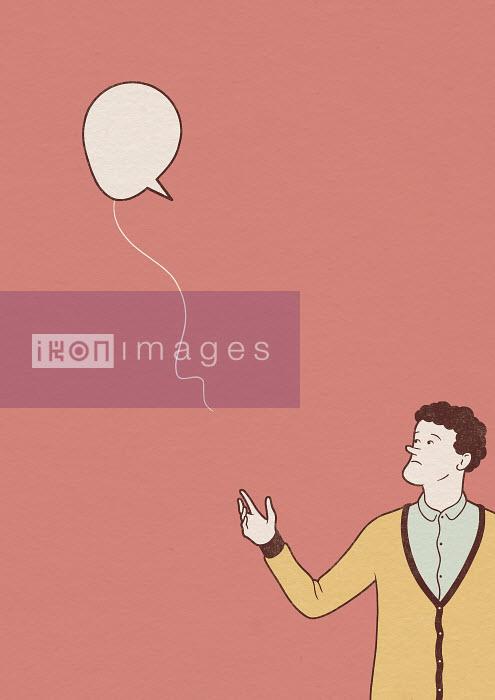 Robbie Porter - Man releasing speech bubble balloon