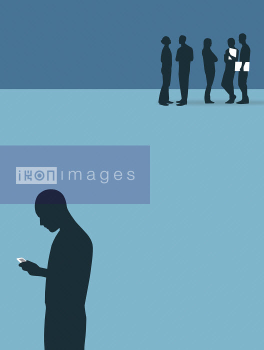Silhouette of man with cell phone standing isolated from group of people - Silhouette of man with cell phone standing isolated from group of people - Nick Lowndes