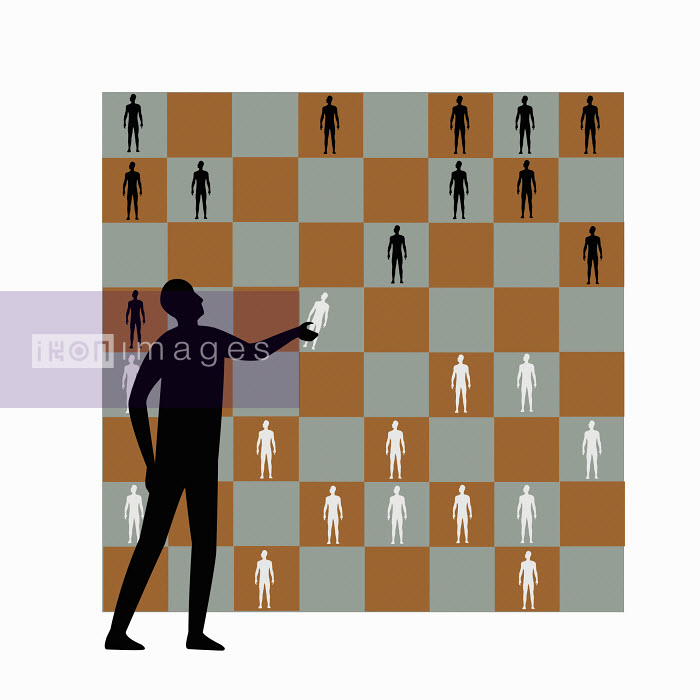 Man playing chess with human figures - Man playing chess with human figures - Nick Lowndes